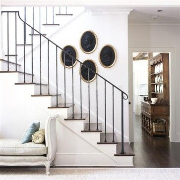 Wrought iron stair rail by Calhoun Design & Metalworks. Finish is a combination of paint and wax.