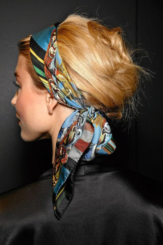 Pulled back with a scarf: