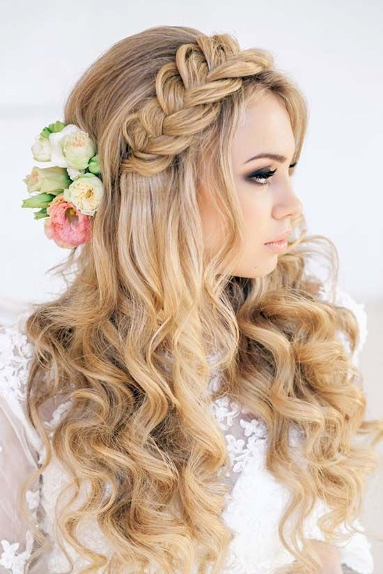 Braided with flowers bridal hairstyle - Long hair, rustic, simple. See more: http://www.weddingforward.com/timeless-bridal-hairstyles/ #weddinghairstyles #bridalhairstyles