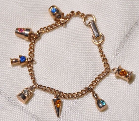 PRETTY GOLD TONE CHARM BRACELET, SEVEN CHARMS WITH GEMSTONE COLORED RHINESTONES #CharmBracelet