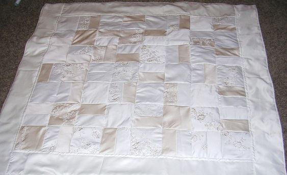 a picture of a custom made wedding dress quilt...