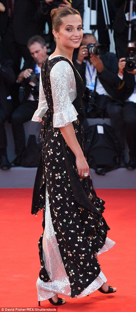 Distinctive: Alicia's ensembleconsisted of a plunging black floral…