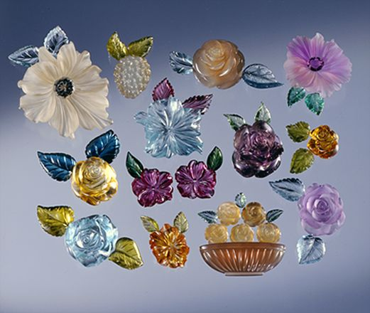 Assorted fantasy flowers and berry carved from moonstones, with leaves of tourmaline and aquamarine:
