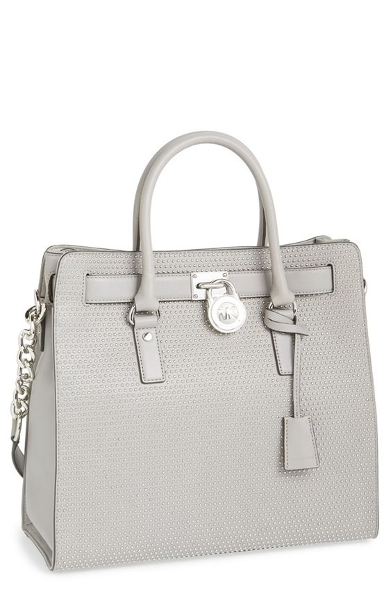 A bolsa é para as mulheres, como o carro é para os homens!!! Michael Kors