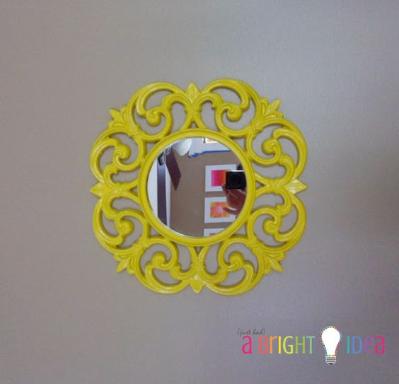 A bright idea to paint this mirror frame. I wouldn't have used yellow, but it looks neat anyway.