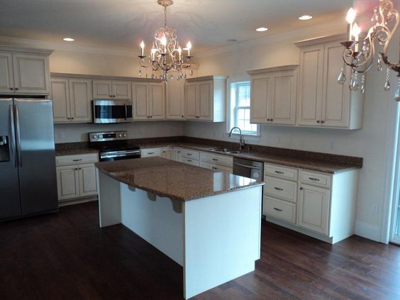 Custom kitchen of a Brookside with Cambria Quartz kitchen countertops in color Brown Hill (12-77)