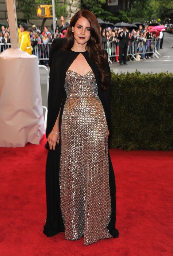 Lana Del Rey in Altuzarra @ Met Gala Ball 2012 - I am seriously obsessed with Lana Del Rey, she is so perfect, I love the cape that subdues the metallic gown. Old hollywood glamorous.