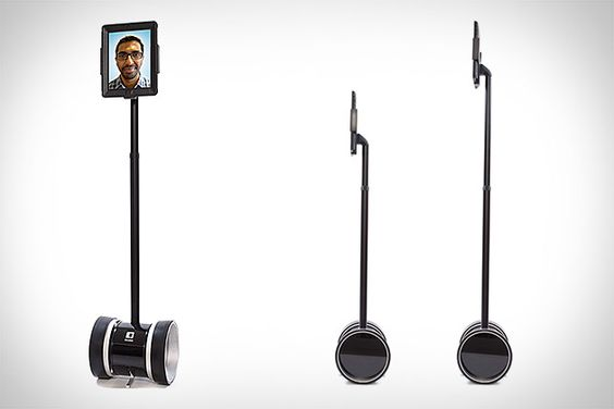 """Double Robot:  robot that mounts an iPad atop a motorized stand, letting you see, hear, and move about far-away environments using nothing but an iPad on the other end. A touch-based interface makes controlling the Double a breeze, while an accelerometer and gyroscope work to keep the 10""""-wide robot stable until you're done moving it, at which point dual kickstands pop out to let the battery take a rest. Welcome to the future. $2000"""