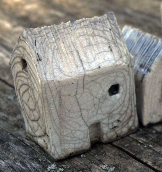 Love the crackle on this tiny Raku house.  Mark Strayer, North Star Pottery
