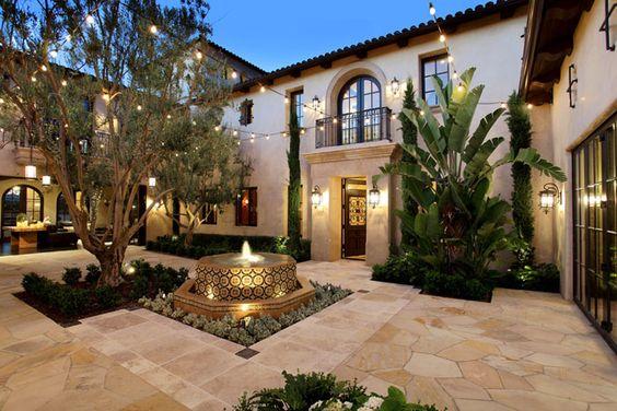 Courtyards santa barbara and rob lowe on pinterest for Hacienda style lighting