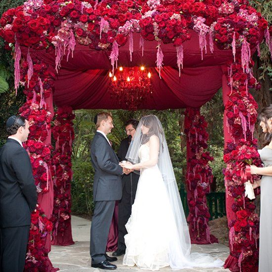 This lavish chuppah completely covered in red florals was the focal point for this gorgeous outdoor ceremony at Hotel Bel-Air. So beautiful and great for pictures makes the bride and groom stand out.