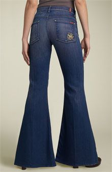 """Bell bottoms. It was always the bigger the """"bell"""" the better! Ohhhh! Who remembers adding lace or some other material to the bottom when they got too short? Surely it wasn't just me! :)"""