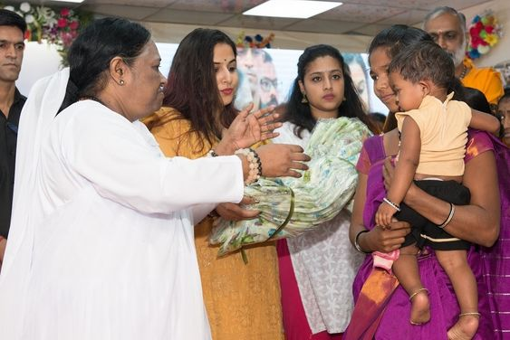 Actor Vidya Balan along with Amma distributed sarees to the ladies