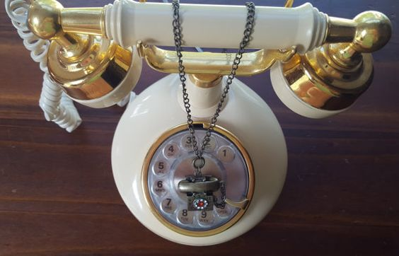 Check out this item in my Etsy shop https://www.etsy.com/listing/234444060/pendant-necklace-brass-vintage-telephone