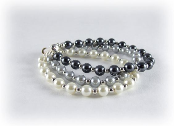 Shades Of Gray Bracelet- Light Medium and Dark Pearl Bracelet- Three Strand Pearl Bracelet. $18.00, via Etsy.