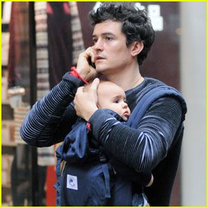 Orlando Bloom with Baby Flynn in an Ergobaby carrier.  Woo Woo!