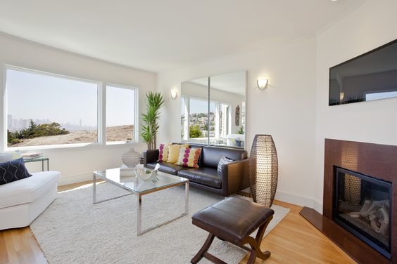 Complete remodel of a home opening layout to add sunlight and an expansive hilltop view with modern design in Eureka Valley San Francisco, CA