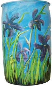 Lovely, purple irises blow in the wind while reducing stormwater runoff on Barb & Art Barlow's 2013 barrel.