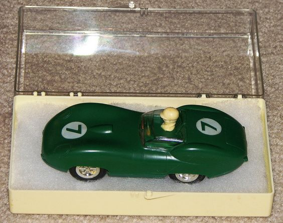 This slot car was made by Louis Marx & Co. Inc., 200 Fifth Ave. N.Y., N.Y. U.S.A. The DC motor was made in Japan.     Slot cars are powered small vehicles that are assisted by a slot or groove set in the tracks on which they run. At the bottom of the car is a blade or pin that keeps the car in the slot. To make the car run, the metal strips placed next to the slot d
