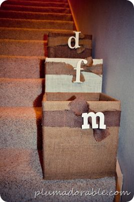 """bulrap covered cardboard boxes... Inexpensive way to declutter """"the stuff that needs to go upstairs"""" & everyone has their own box they're responsible for! Love!"""