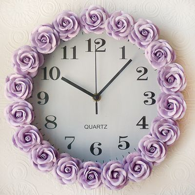 "Lavender Rose Wall Clock from Layla Grayce.  Taking ""time"" to smell the roses, this dreamy wall clock adds the finishing touch to the design of the room. Gorgeous large lavender Mulberry paper roses adorn it for vintage appeal."