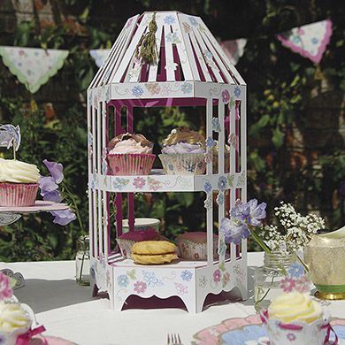 A tower of sweet treats to make your guests' eyes light up and their taste buds start tingling. This cake tower centre piece is beautifully decorated and has two tiers for displaying your delicious delights. It is embellished with a tassel.