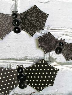 Make these simple Button Bat craft using Halloween scrapbook paper and black buttons
