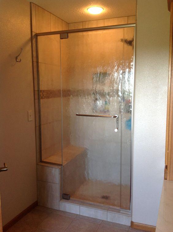 Custom shower with built-in bench and custom door