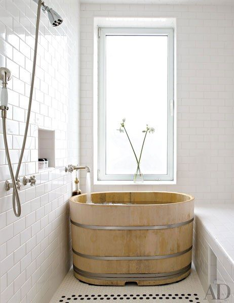 Japanese hinoki-wood soaking tub in a soothing all white bathroom: