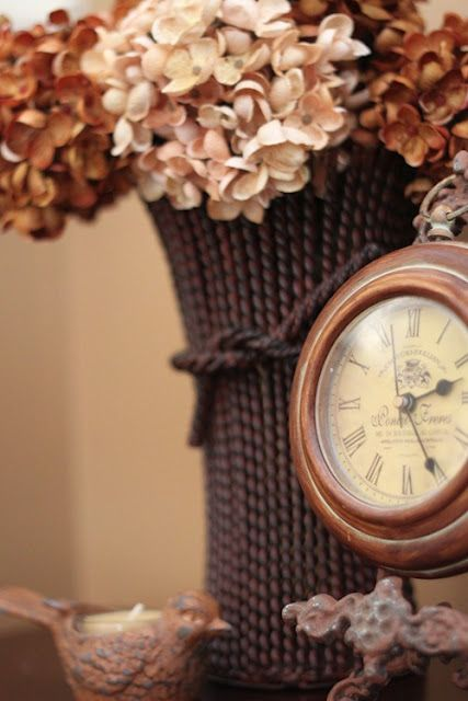 dried brown and pink hydrangea tablescape with clock Brown and bronze