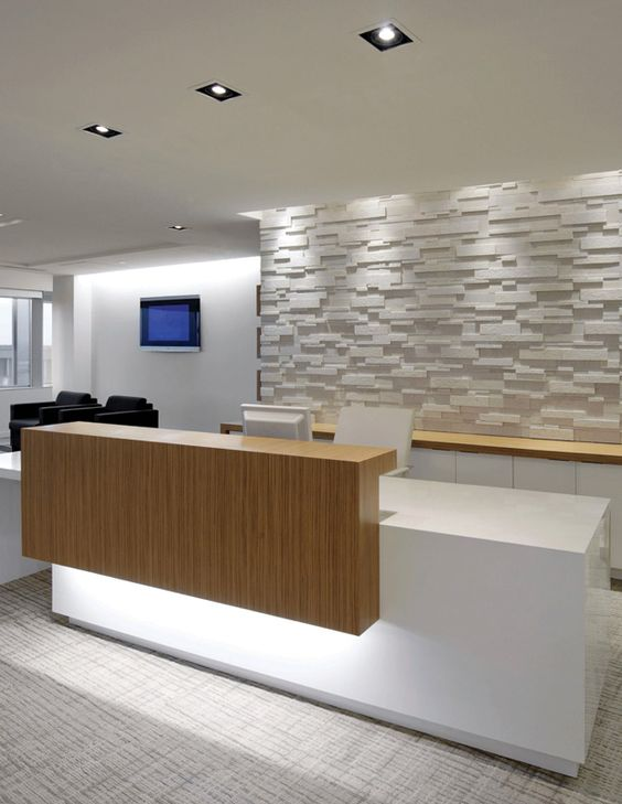 beautiful reception desk textured white wall blonde wood and lighting blonde wood office