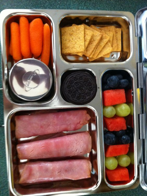 Aliyah's lunch 9/4/13: ham and cheese roll-ups, carrots w/ranch dip, wheat thins, fruit and and Oreo !