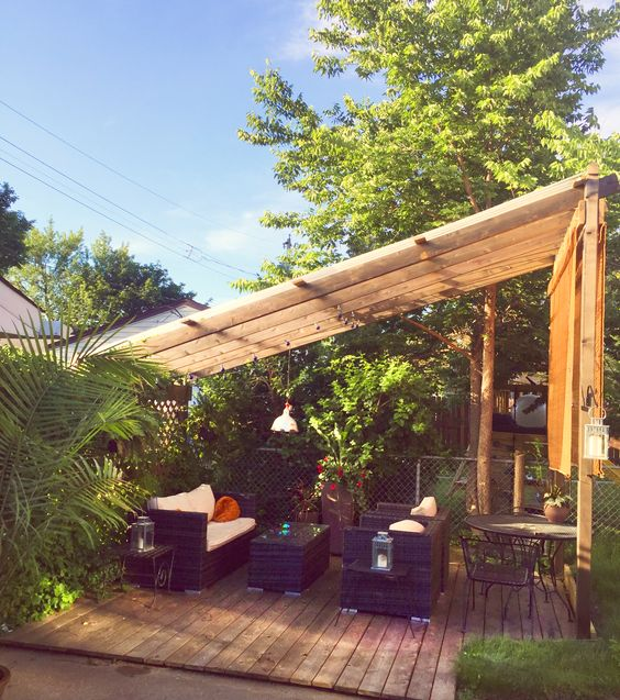 Our backyard patio chillspot. Is it an arbor, trellis, or outside living space? I'm not sure, but it has clear plastic UV panels so we can sit and watch the rain.