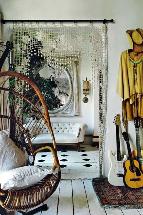 A crocheted curtain puts a chic twist onto the entryway of an understated room.