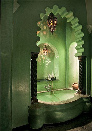 What an eerie yet beautiful bath w/ various     shades of green !!!This fabulous bath is in La Sultana Hotel in Marrakech,Morocco.