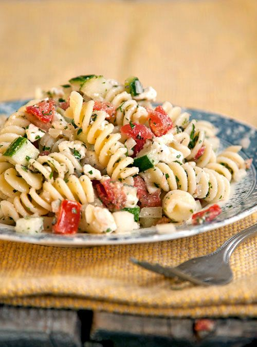 Greek Pasta Salad: 10 oz. rotini, cooked and chilled 2 medium tomatos, cored, seeded and cut into ½ inch dice  1 small cucumber, cut into ½ inch dice 1 small onion, finely chopped 1 cup feta cheese, crumbled 3 tbsp. chopped fresh oregano 3 tbsp. chopped fresh parsley 3 tbsp. red wine vinegar ¼ cup olive oil Salt and freshly cracked black pepper, to taste