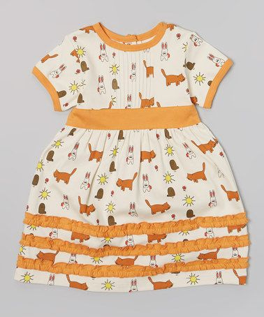 I honestly don't know why I love this, but I do.  Look at the kitties and bunnies on it.  @Charity Maas Sloan make isla this dress.