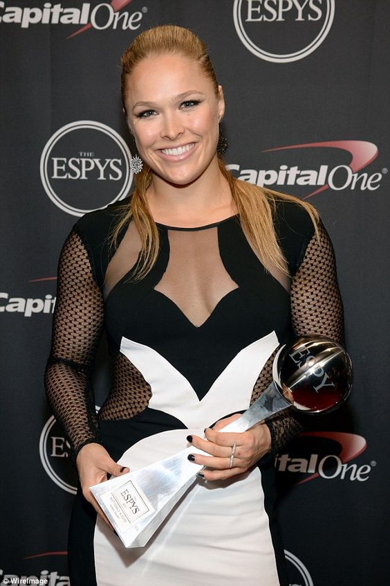 Rising star: UFC fighterRonda Rousey (pictured) was named Best Fighter and Best Female Athlete at the ESPY Awards on Wednesday night