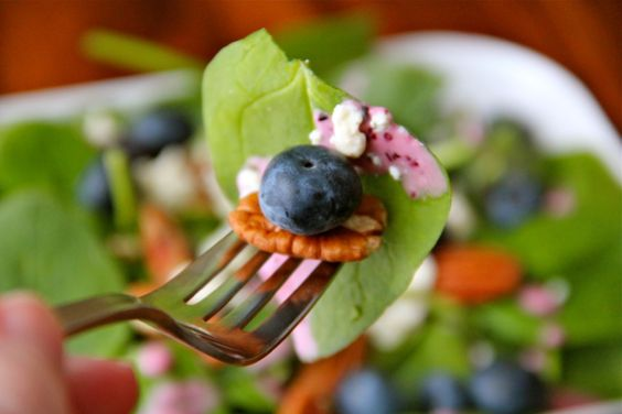Blueberry & Bleu Cheese Salad with pecans and fresh blueberry vinaigrette. Yum.