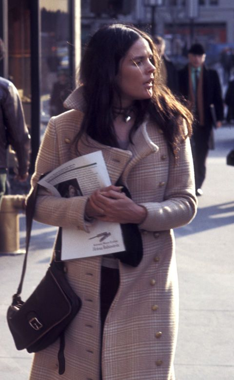 Ali MacGraw proves over and over again that chic outerwear is essential for fall fashion.