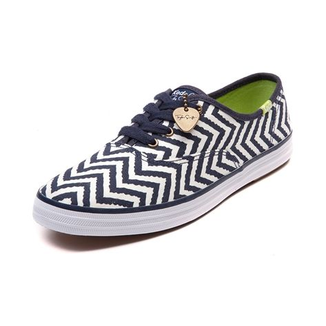 Shop for Womens Taylor Swift Keds Champion Casual Shoe in Navy at Journeys Shoes. Shop today for the hottest brands in mens shoes and womens shoes at Journeys.com.Taylor Swift edition Keds Champion featuring an exclusive navy and white chevron print canvas upper, lace closure, and rubber sole. Includes guitar pick charm with a Taylor Swift printed signature. Available exclusively at Journeys and SHI!