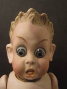 Vintage bisque german character doll. Scared expression.