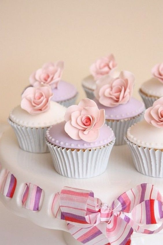 Pretty pastel pink & lavender cupcakes on a cake plate