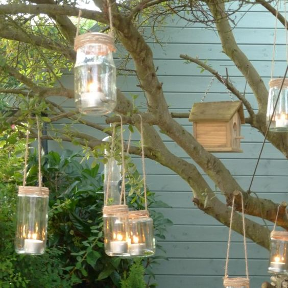 Garden lanterns. Glass jars wrapped in garden twine