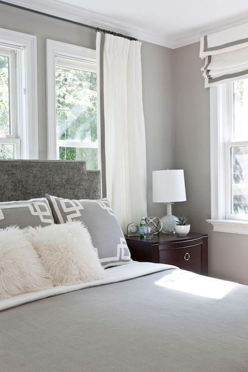 Gray bedroom features gray walls framing gray velvet - Grey white and silver bedroom ideas ...