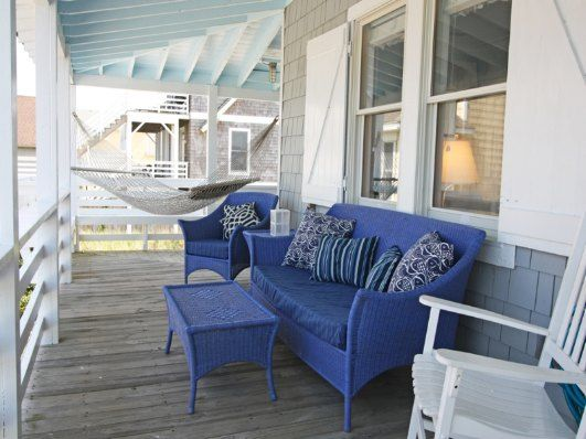 Oceanfront/Back Side of Wrap-Around Porch with Dining and Lounge Furniture  cute!