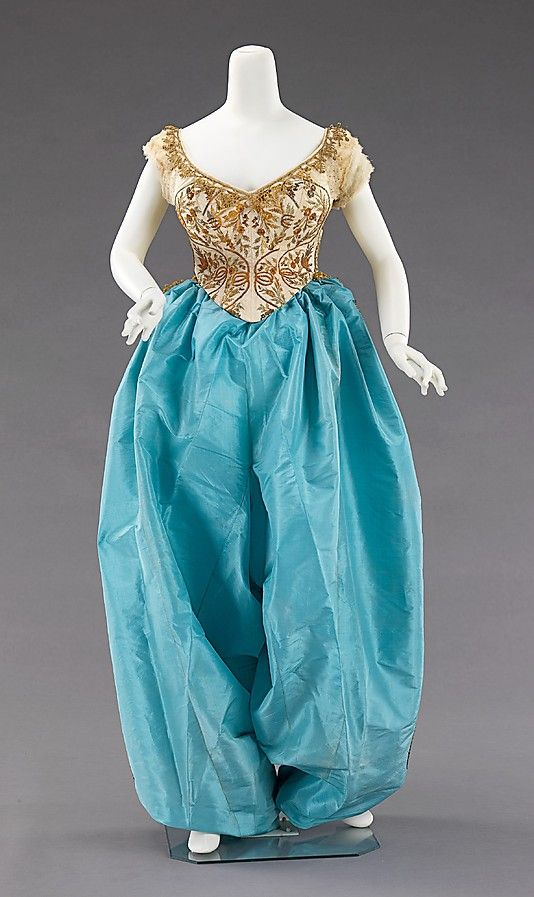 ancy dress costume House of Worth (French, 1858–1956) Designer: Charles Frederick Worth (French (born England), Bourne 1825–1895 Paris) Date: ca. 1870 Culture: French Medium: silk, metal Dimensions: Length at CB (a): 35 in. (88.9 cm) Length at CB (b): 54 in. (137.2 cm)