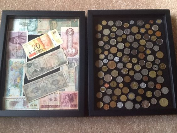 Shadow Boxes with money we have collected in our travels around the world.  Using them to decorate a travel themed office.