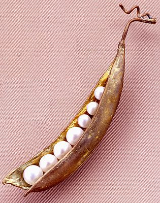 "Peapod Pin by Michael Michaud. Freshwater pearls nestled inside hand-patinaed bronze pod. 3 x 1/2"":"
