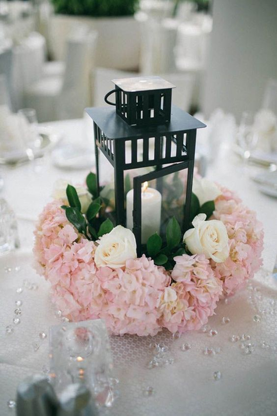 Black lantern and pink flowers wedding centerpieces